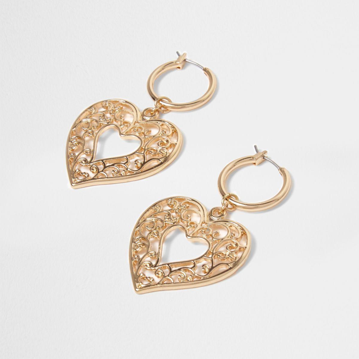 Gold tone heart dangle hoop earrings