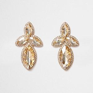 Pendants d'oreilles dorés ornés de pierres