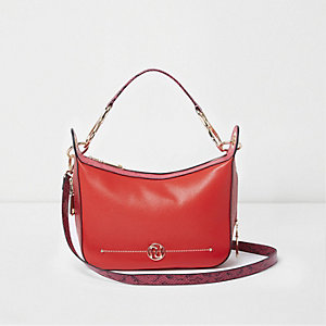 Orange zip side scoop cross body bag