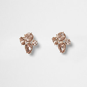 Clous d'oreilles façon or rose avec pierre