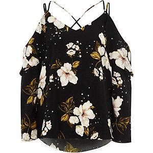 Top Bardot à fleurs noir à volants et bretelles croisées dans le dos