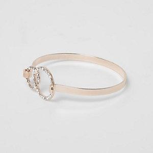 Roségoudkleurige armband met cirkel bezet met diamantjes