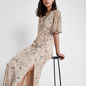 Nude maxi-jurk met pailletten en uitlopende mouwen