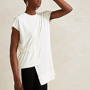 Cream RI Studio asymmetric hem top