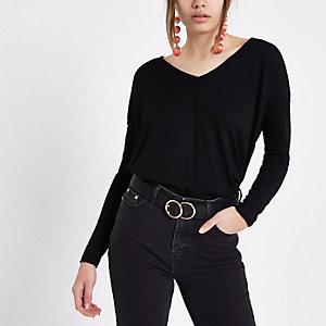 Pull noir avec col en V et dos torsadé