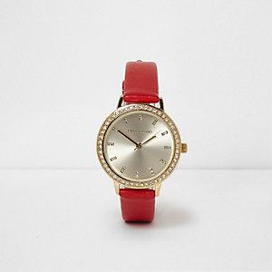 Rood horloge met ronde wijzerplaat en siersteentjes