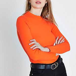 Oranje geribbelde hoogsluitende top met lange mouwen