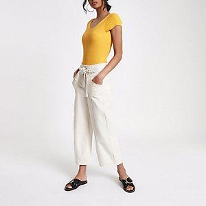 Yellow scoop neck bodysuit