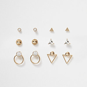 Set goudkleurige geometrisch gevormde oorbellen met diamantje