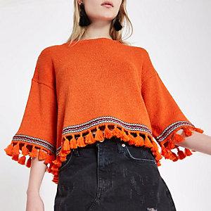 Pull imprimé aztèque orange avec manches larges et bordure à franges