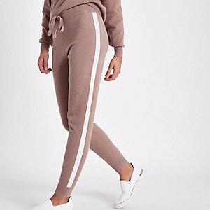 Pantalon de jogging en maille rose clair rayé sur le côté