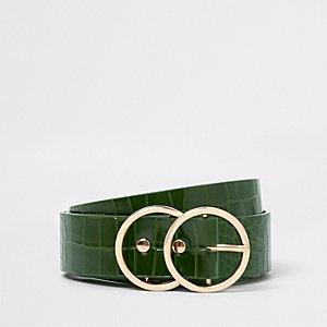 Donkergroene riem met dubbele ring en krokodillenprint in reliëf