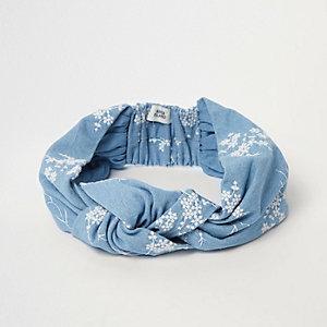 Blauwe denim geborduurde hoofdband met knoop