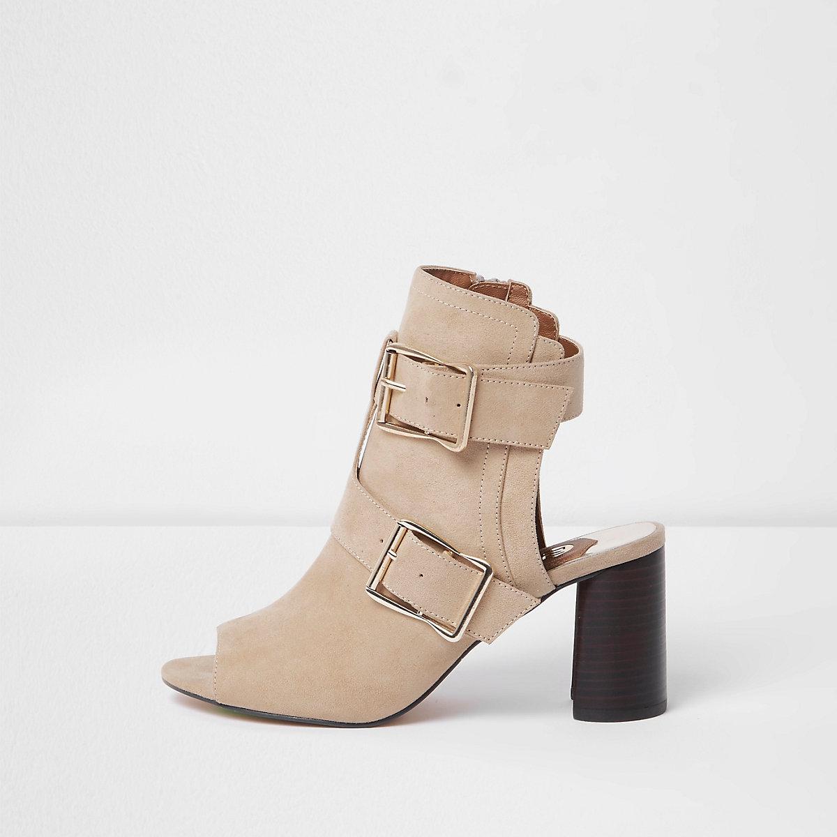 Beige multi buckle block heel shoe boots