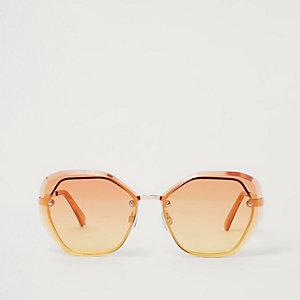 Oversized glamoureuze zonnebril met oranje glazen