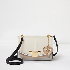 Cream lock front cross body bag