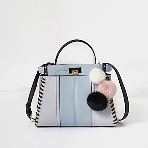 Blue whipstitch pom pom cross body tote bag