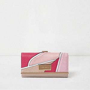 Pinke Geldbörse mit Zierausschnitten
