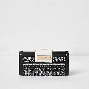Porte-monnaie noir à fermoir clip et boucle sur le devant