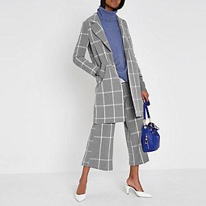 Manteaux à carreaux gris