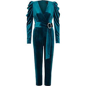 Turquiose blauwe fluwelen jumpsuit met pofmouwen