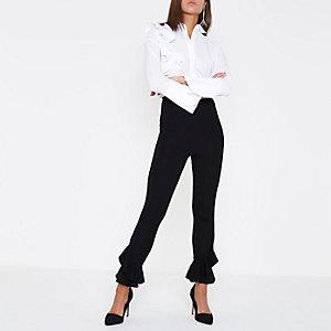 Zwarte legging met uitlopende zoom