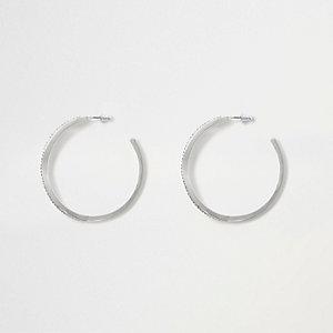 Silver tone rhinestone pave twist hoop earrings