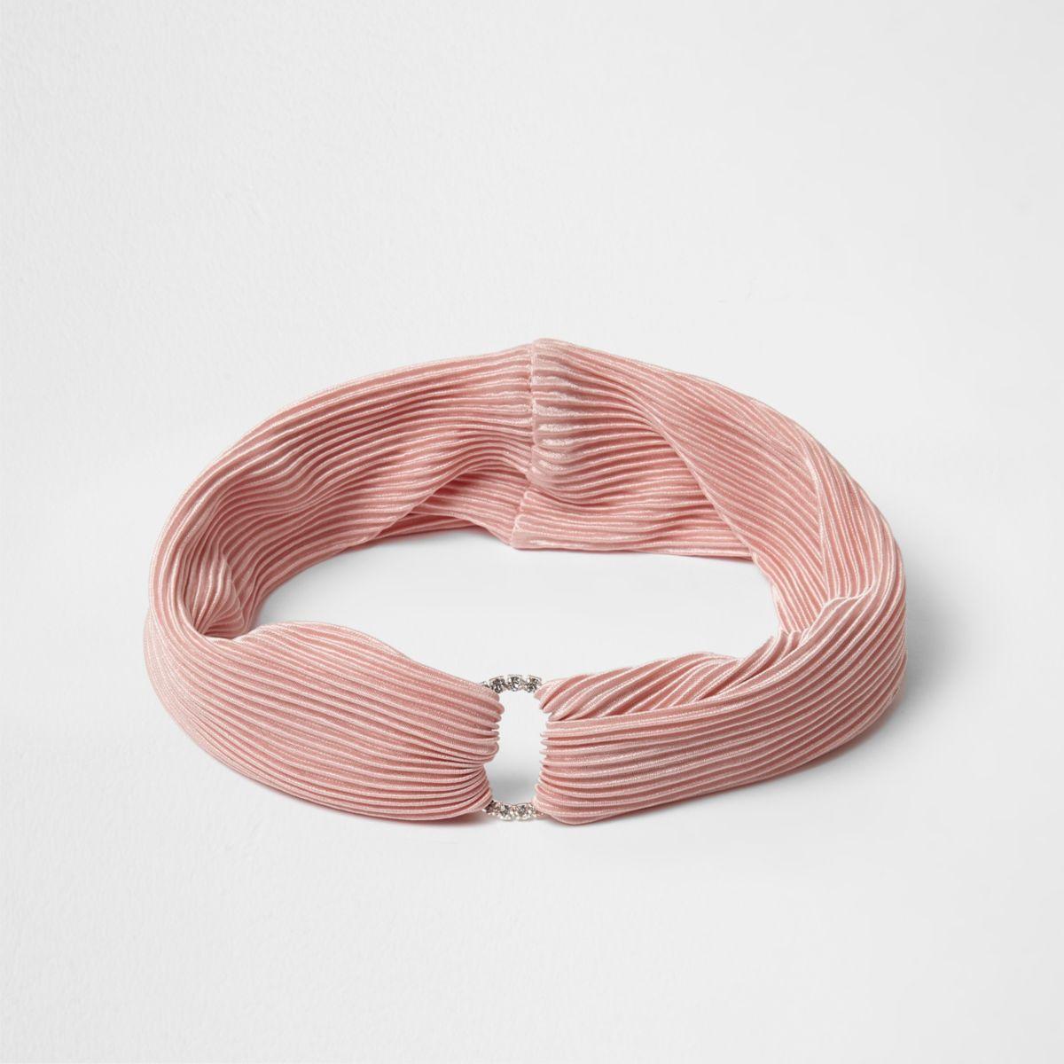 Roze geplooide hoofdband met cirkel bezet met diamantjes