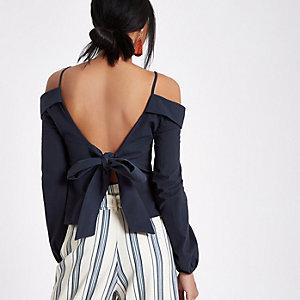 Marineblauwe schouderloze top met strik op de rug