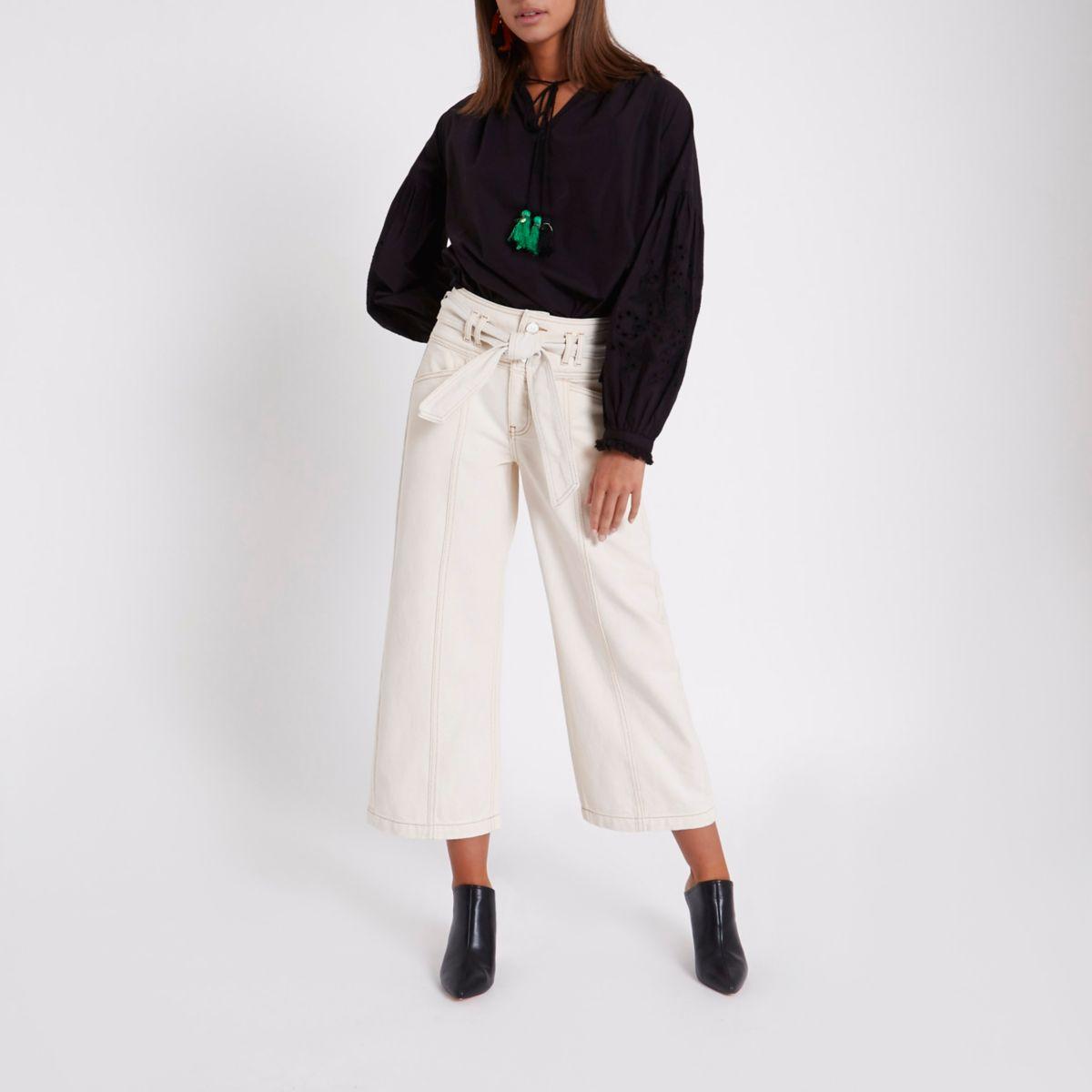 Crème cropped jeans met wijde pijpen en riem