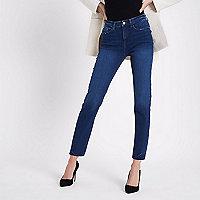 Donkerblauwe slim-fit jeans Casey met onafgewerkte zoom