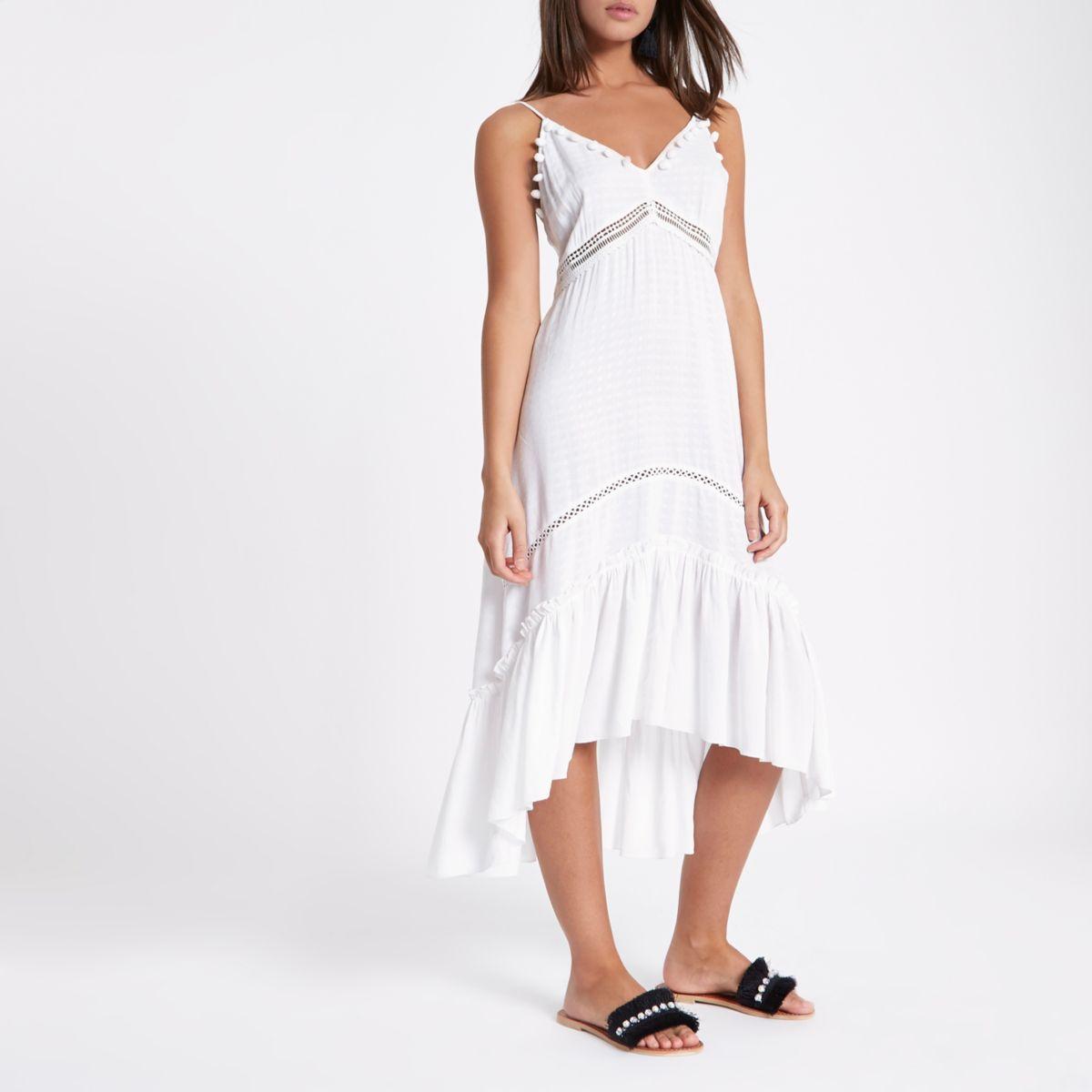 White pom pom trim beach dress