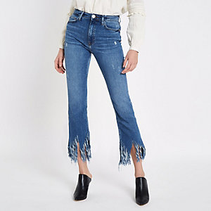 Mid blue fringed hem cropped flare jeans