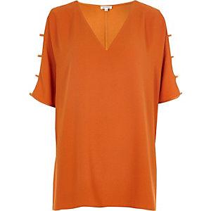 Oranje T-shirt met V-hals en mouwen met uitsnedes