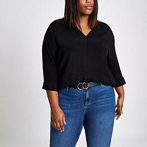 RI Plus - Zwarte ruimvallende blouse met gekruiste banden op de rug