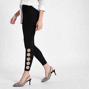 Legging noir avec ourlets à œillets oversize