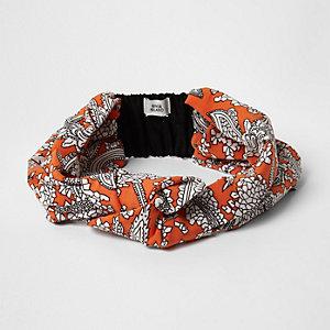 Serre-tête orange avec nœud à motif floral