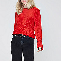 Red ruched hem long sleeve towelling top