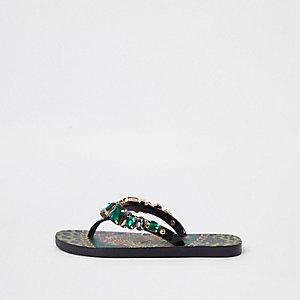 Green jewel embellished flip flops
