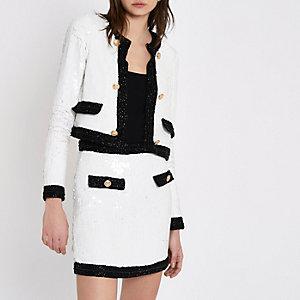 Mini-jupe blanche avec bordure contrastante à sequins