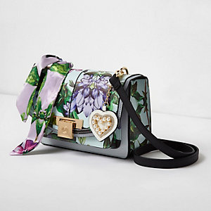 Blue floral print lock front cross body bag