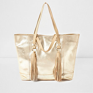 Metallic gouden leren shopperhandtas met kwastjes