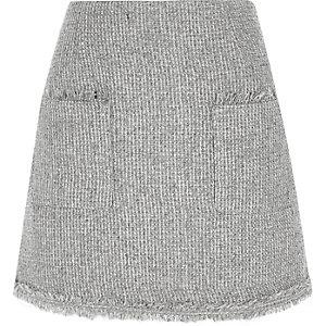 Mini jupe maille boucle pailletée avec poche sur le devant grise