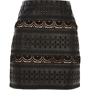 Black faux leather broderie detail mini skirt