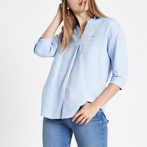 Light blue cross back blouse
