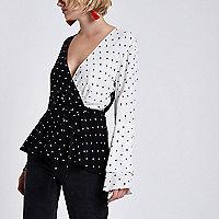 Schwarze Bluse mit Punkten und Taillengürtel