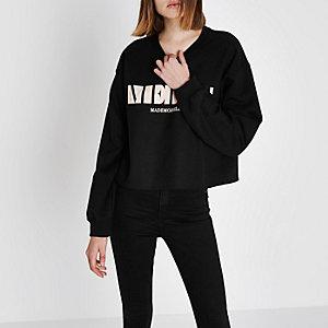 Zwart sweatshirt met 'merci'- en blokprint