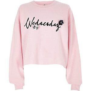 Roze 'Wednesday' sweatshirt met flockprint en 3D-bloem