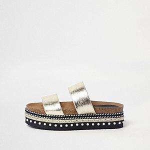 Metallic gouden slippers met plateauzool en versiering