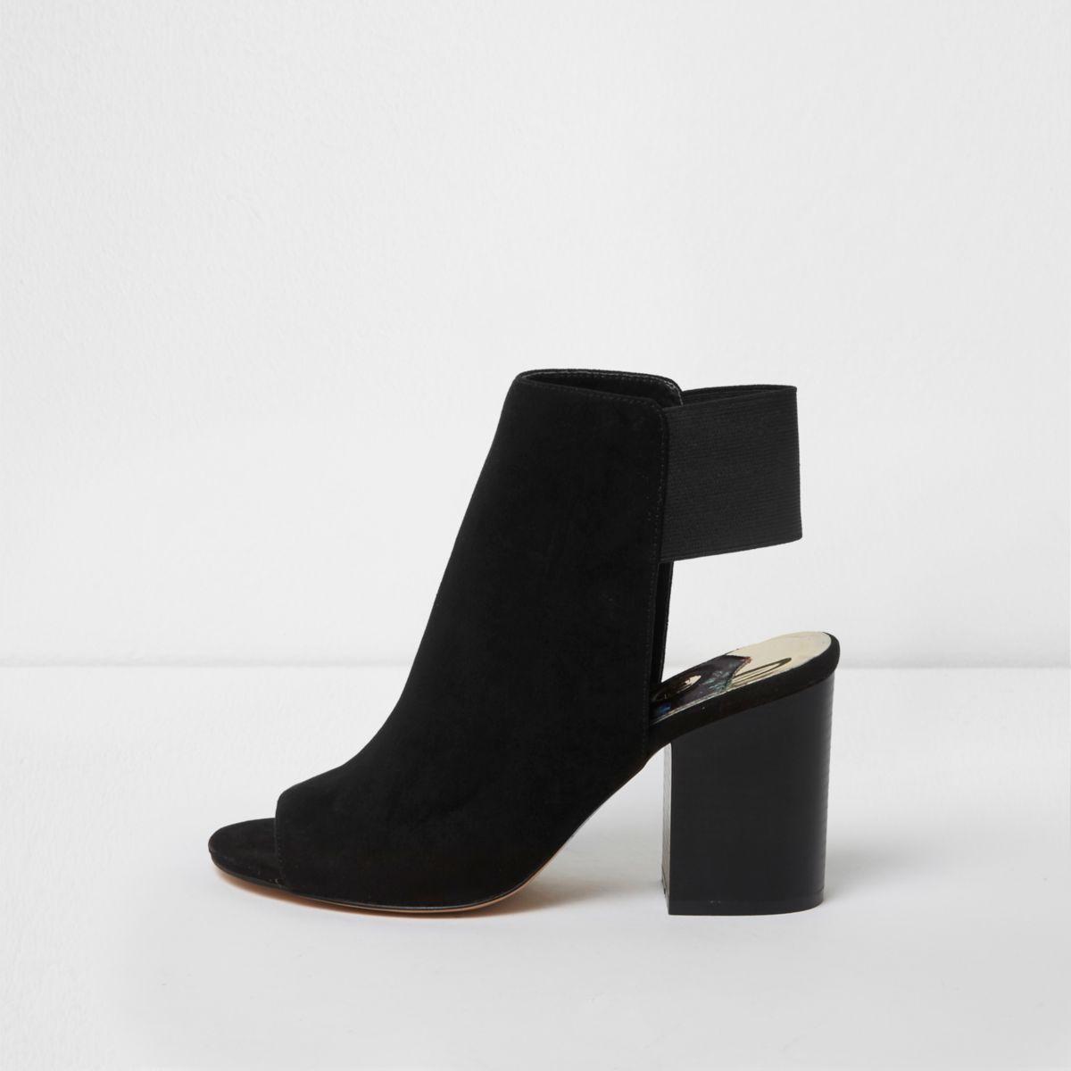 Black block heel shoe boots